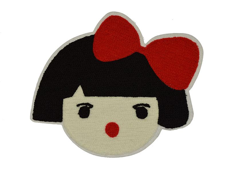 meisje met rode strik applicatie badstof 17 x 21 cm
