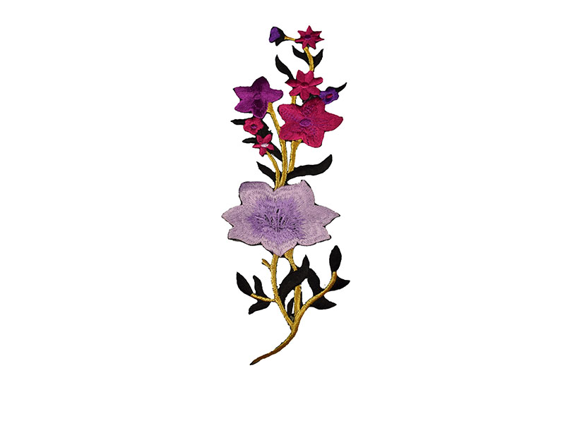 paarse en lila bloemen patch op een gouden tak